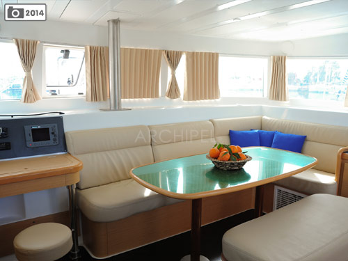 The panoramic interior lounge of the catamaran connects to the four cabins.
