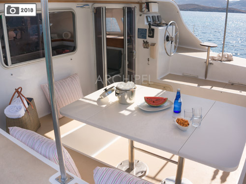 In the Greek islands where the mild climate invites you outdoors, the Punch catamaran's verandah offers a friendly space for meals and relaxation.